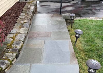 Variegated full color bluestone steps and sidewalk in Thomaston, Connecticut.